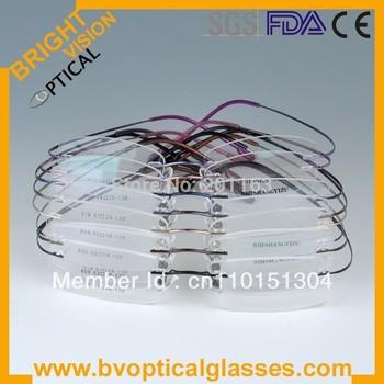 Free shipping 8 colors rimless hingless memory titanium eyeglasses eyewear optical frames 1001