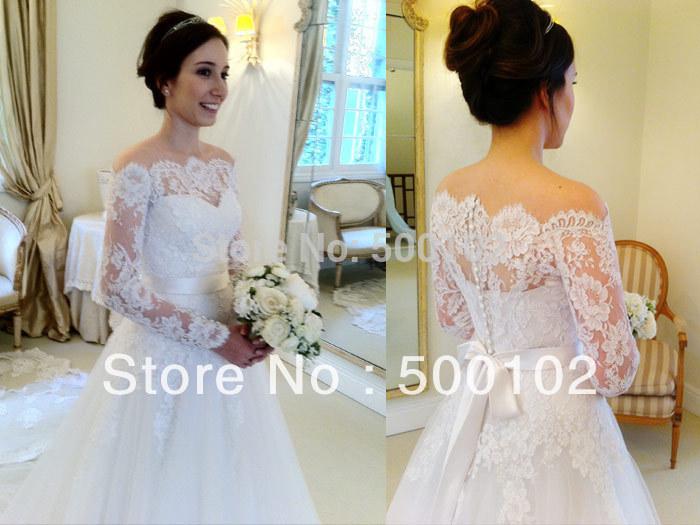 Vintage. une ligne de l'épaule à manches longues robes de mariée en dentelle