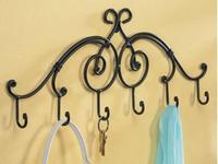 Black ,white, bronze towel rack w hangers door after hanging clothes hook screw