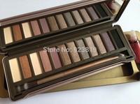 High quality NK2 12 color eye shadow palette+Lip gloss  free shipping