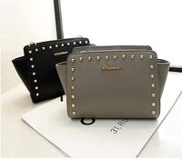 2014 new  women's fashion handbag rivet smiley bag portable women's rivet handbag messenger bag  free shipping