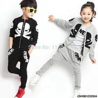 Spring models child skulls sports suit boys and girls children Pure cotton three-piece set 121104 size 100-140
