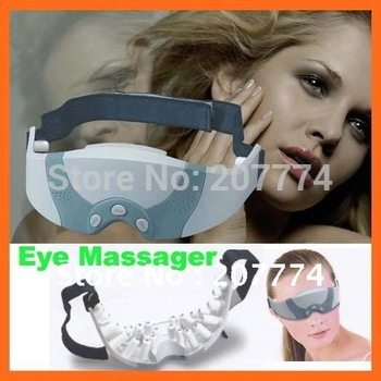 Free shipping! Mask Migraine DC Electric Care Forehead Eye Massager 110V US Plug &220V EU Plug With Retail Box