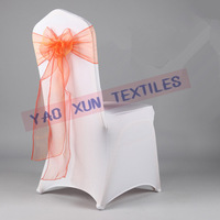 Wedding Chair Cover In White Color With Orange Organza Chair Sash