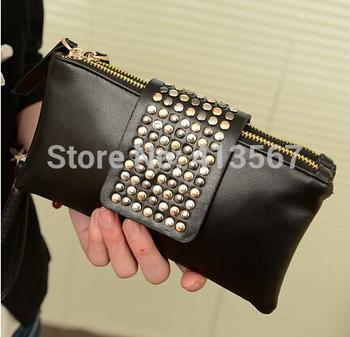 http://i01.i.aliimg.com/wsphoto/v3/967538021_1/Chritmas-2014-Vertical-PU-Leather-Brand-Fashion-Designer-Wallet-for-Women-studs-purse-Card-Holder-rivet.jpg_350x350.jpg