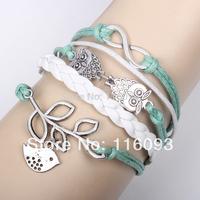 infinity thong bracelet ,olive branch ,peace dove charm  bracelet  leather