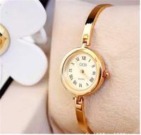 2014 New women watch Luxurious women rhinestone watches Women Watch Famous New Brand Crystal Ladies Wristwatch Hours