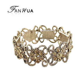 Accessories for woman new 2014 charming gold color alloy hollow out flower imitation crystal adjustable bracelets and bangles