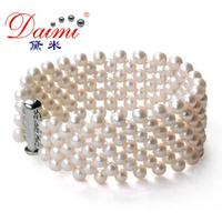 Pearls by DAIMI Charming White Fresh Water Pearl 4 Row Web Bracelet .