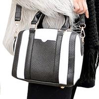 Female bag bag in Europe and the wind big black and white stripe handbag color matching color OL temperament of one shoulder