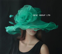 Green Organza Hat with organza flower and cocktail feathers for Church and wedding.Brim width 13cm.